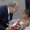 Mawlana Hazar Imam being presented with a bouquet of flowers by seven-year-old Ramla Saleh upon arrival in Nairobi.