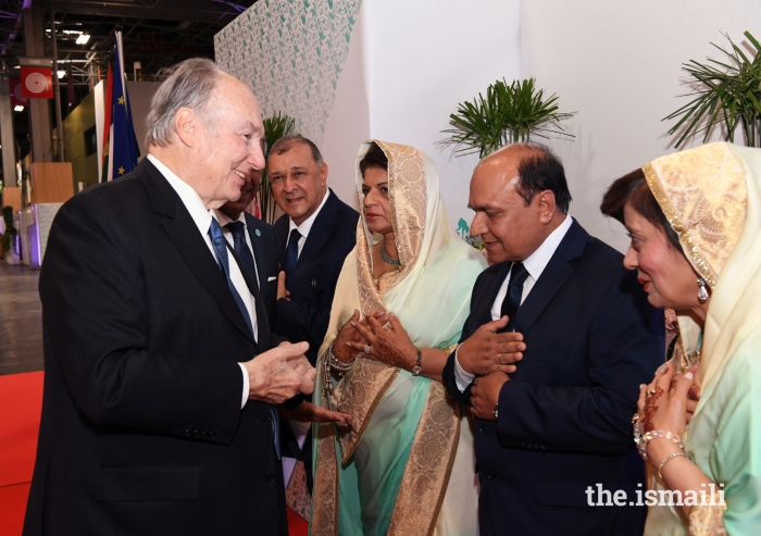 Mawlana Hazar Imam is received at the Darbar hall by Mukhi Saheb, Mukhiani Saheba, Kamadia Saheb, and Kamadiani Saheba of Paris Principle Jamatkhana.