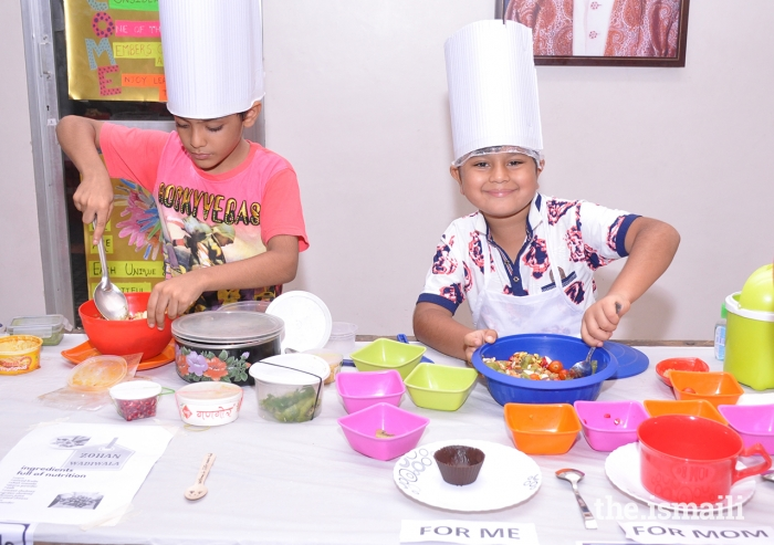 Children from the India Jamat participate in the Little Master Chef programme, which aims to help form healthy eating habits during the younger, impressionable years.
