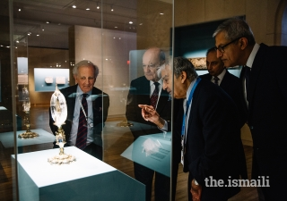 Curator, Dr. Assadullah Souren Melikian-Chirvani, shows an artefact to Prince Amyn, AKDN Resident Representative to Canada Dr. Mahmoud Eboo, Aga Khan Trust for Culture General Manager Luis Monreal, and Ismaili Council for Canada President Malik Talib.