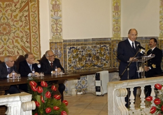Mawlana Hazar Imam speaking at the International Symposium at the University of Evora, watched by (left to right): Rector of the University of Evora, Professor Manuel Patricio; President Sampaio; and Professor Adriano Moreira.