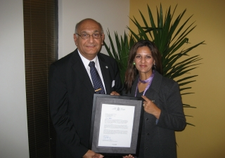 Gulam Juma, Coordinator of the FOCUS International Coordinating Committee and Mina Mawani, CEO of the Ismaili Council for Canada accepted a letter from the Government of Canada, recognising and honouring their respective organisations for their work in re