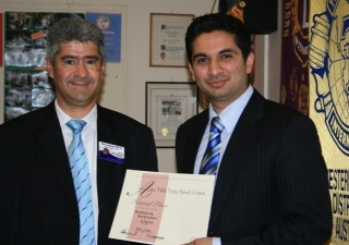 Hussain Rajwani (right) of Sydney, Australia was awarded second prize in a Toastmasters divisional competition.