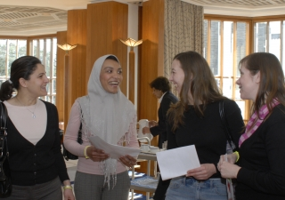 Women of diverse backgrounds exchange stories and ideas at the International Women's Day event held at the Ismaili Centre, London.