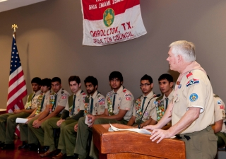The keynote speaker, Congressman Pete Sessions, addresses the audience about the importance of scouting and community service.