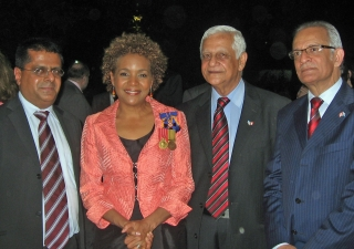 The three Ismailis who were recognised for their services as Canadian wardens in the DRC pose for a photograph with Governor General Michaëlle Jean. From the left: Altaf Sheriff, the Governor General, Sadrudin Nanji, Shiraj Hemraj.
