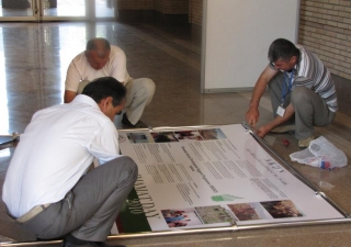 Volunteers hard at work setting up displays for the AKDN Exhibition at the Ismaili Centre, Dushanbe.