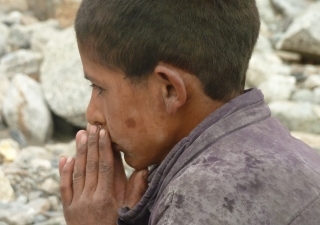Life after the devastating floods — a boy lost in thought in Darkut, Gilgit-Baltistan.