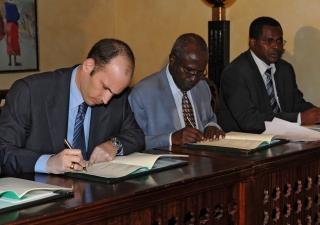 Prince Hussain, Professor Karega Mutahi, and Dr Jacob Ole Miaron PhD, sign a memorandum of understanding for the restoration and rehabilitation of Nairobi's City Park.
