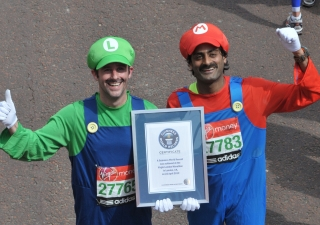 "Runners Nash Pradhan and Dan McCormack completed the 2012 London Marathon in support of the Aga Khan Development Network. The pair set a Guinness world record for ""Fastest marathon dressed as a video games character""."