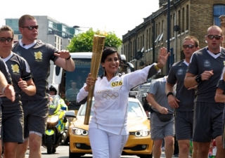 Zahra Jessa runs as a torch bearer in the 2012 London Olympics on 25 July.