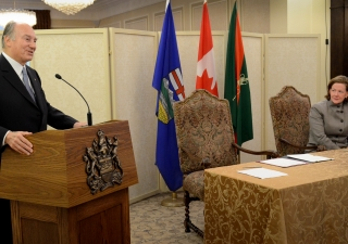 Mawlana Hazar Imam addresses the gathering at Government House, as Alberta Premier Alison Redford looks on.