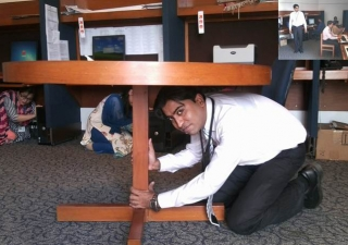 Staff at the Aga Khan University in Karachi Drop, Cover and Hold on during the AKDN ShakeOut drill.