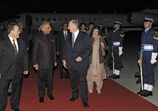 Upon his arrival in Islamabad, Mawlana Hazar Imam is received by Tariq Fatemi, Special Assistant to the Prime Minister on Foreign Affairs, and Aitmadi Iqbal Sadru-Dean Walji, President of the Ismaili Council for Pakistan.
