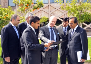 Prince Amyn inspects plans at the Centro Ismaili in Lisbon with President Amirali Bhanji of the Ismaili Council for Portugal, Rahim Kara, the Centro Ismaili building manager and other senior management.