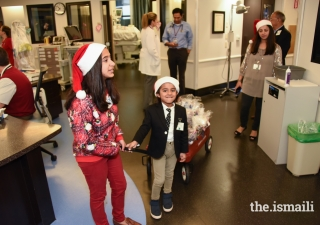 Maya and Tabish Tharoo doing their Christmas rounds at Winnie Palmer Hospital, Miami.