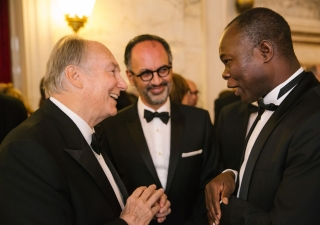 Mawlana Hazar Imam with Aga Khan Award for Architecture Director Farrokh Derakhshani and 2004 laureate Diébédo Francis Kéré.