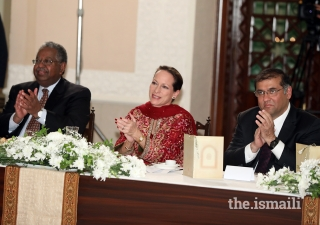 Left to right: Dr Haile T. Debas, Chairman pro-te​m, Princess Zahra Aga Khan Member, AKDN Board of Directors, and Hafiz Sherali, Ismaili Council for Pakistan President, applauding the performance at the institutional dinner held at Serena Hotel Islamabad