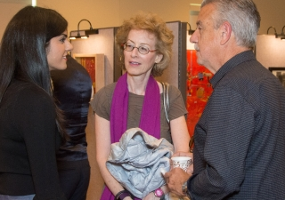 Curator of the event, Al-Qawi Tazal Nanavati, speaks to Felice Dubion, Vice President and Dean of Student Affairs at the School of the Art Institute of Chicago, and her husband.
