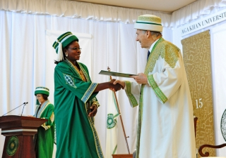 An AKU graduand in Dar es Salaam receives her degree from Mawlana Hazar Imam, the Chancellor of the Aga Khan University. AKDN / Aly Ramji