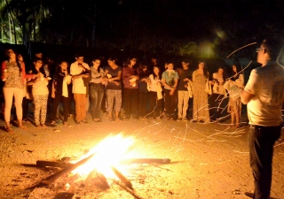 Global Encounters campers gather around a bonfire in Zanzibar. Saraan Jiwani