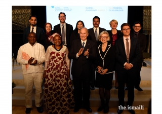 Mawlana Hazar Imam and Chief Justice Beverly Mclaughlin join the inaugural Global Pluralism Award recipients for a group photograph.