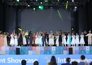 Performers come together as one Jamat for the performance of the official Jubilee Arts song.