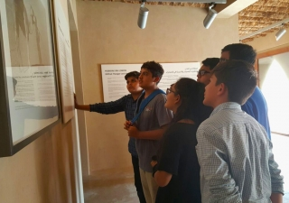 Students learn about the Aga Khan Award for Architecture during a visit to the Al Jahili Fort in Al Ain. Fatima Kamran
