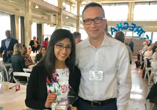 "Sanya received the ""2018 Be the Change award,"" and is seen here with her school Principal,Mr. Sasha Kuznetsov."