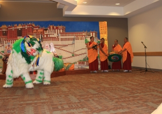 """As part of the Snow Lion Dance, the snow lion tousles the rainbow tassels attached to its ears. The dance demonstrates the spirit of """"the fearless and elegant quality of the enlightened mind."""""""