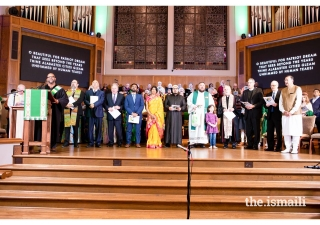 Representatives and members of the various faith-based communities came together on stage for the performance of America the Beautiful.