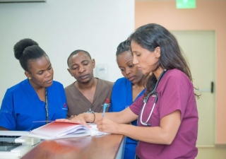 Dr. Lalani training nurses on how to read an ECG, so that heart attacks can be diagnosed rapidly and accurately.