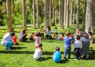 Young learners and their teachers at the Aga Khan Early Childhood Development centre in Khorog, Tajikistan, enjoying a moment of outdoor play.