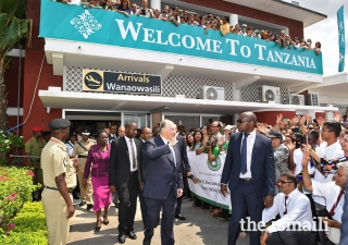 Mawlana Hazar Imam greets Jamati members during his arrivals at the Julius Nyerere Airport in Dar es Salaam.